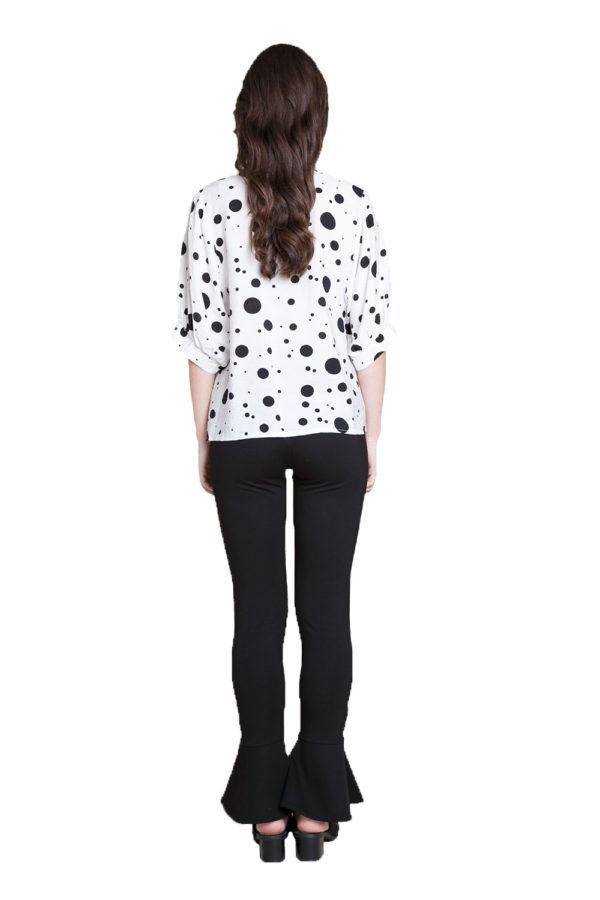 white and black polkadot blouse- back
