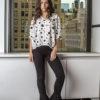 white and black polkadot blouse- front