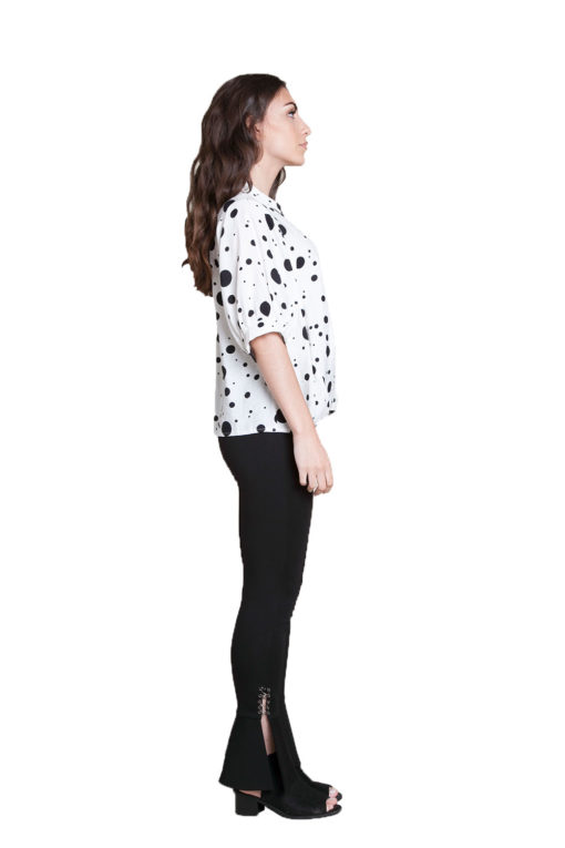 white and black polkadot blouse- side