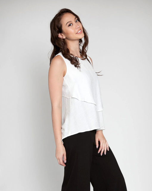 white sleeveless top- side