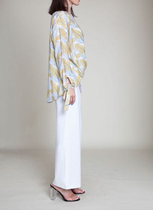 white and yellow feather printed top- side